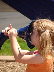 Little girl talking through a large speaking tube