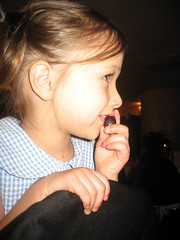 Haven eating a grape and watching everyone dance.