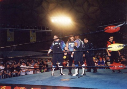 Look at all the people in this picture. The only ones who appear to care that the Dudleys are in the ring are no one.