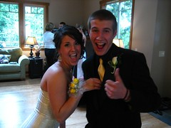 He successfully place the corsage on her wrist!!