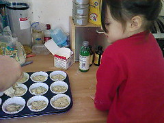 Pour the mixture into the muffin cases.