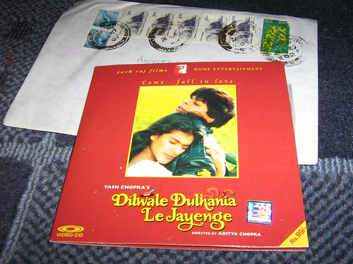 envelope with indian stamps, and a bollywood dvd
