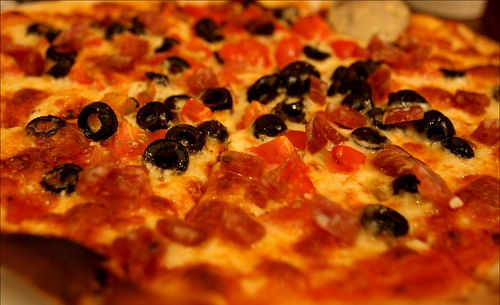 pizza with some olives and salami