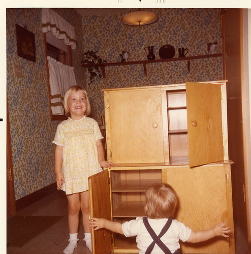 Me, with a cupboard that my grandpa made for my play kitchen - December 1971