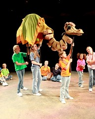 "Members of the Children's Choir perform with the camel designed by Richard Bay in the 2010 Music Circus production of ""Joseph and the Amazing Technicolor Dreamcoat"" at the Wells Fargo Pavilion July 20-25.  Photo by Charr Crail."