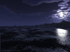 moon and surf and a rocky shore