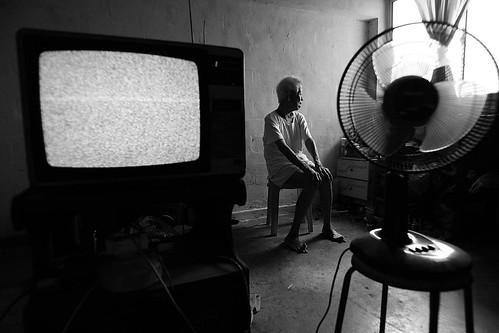 old man , tv , fan ...