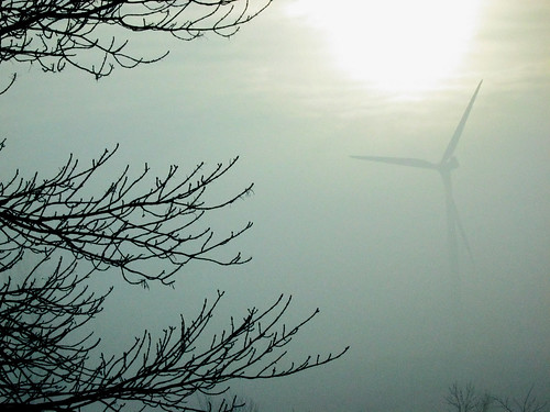 Turbine, sun, and fog