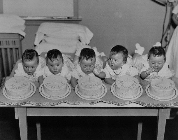 The Dionne quintuplets--Marie, Emelie, Cecile, Annette and Yvonne celebrate their first birthday in style in Callander, Ontario, on May 28, 1935. --- Image by � Bettmann/CORBIS