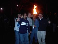 Celebrating in front of bonfire