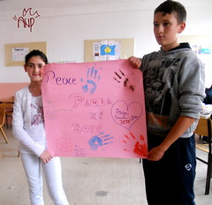 Kids Presenting Peace Paper