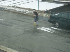 Neighbour sweeping road.