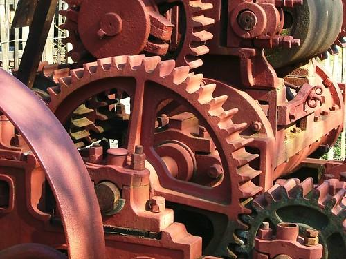 Assorted big rusty mechanical gears.