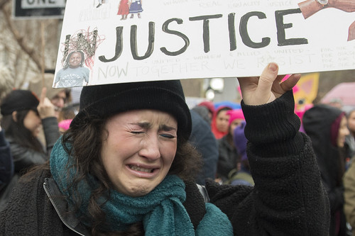 A young girl cries during Women's March in San Francisco after Donald Trump's inauguration, January 21, 2017