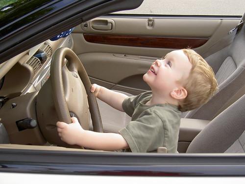 Luke at 3 driving a car.