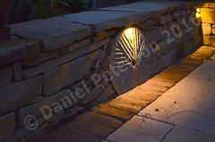 Sandstone-Seating-Wall-with-Millstone-Autumn-2015-evening