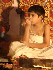 a young boy being initiated in the sacred rituals