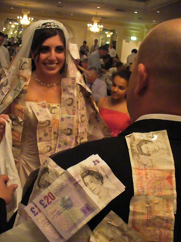 money pinning on bride and groom