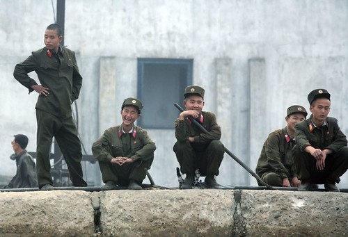 Laughing North Korean soldiers by nataliebehring.com
