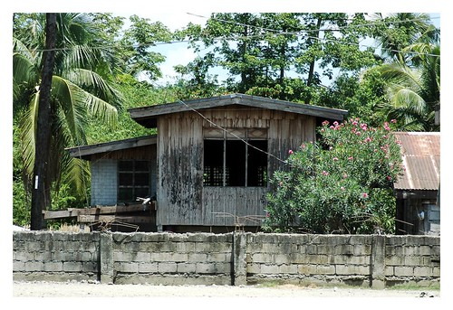 image of a Filipino house with cement fence, borrowed from flickr.com