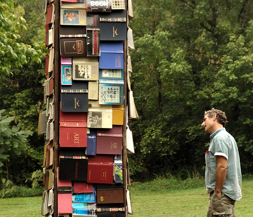 tower of books and a man interested by zen, on Flickr