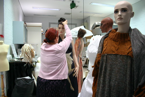 Conservator putting wigs on mannequins 1 by National Museums Liverpool