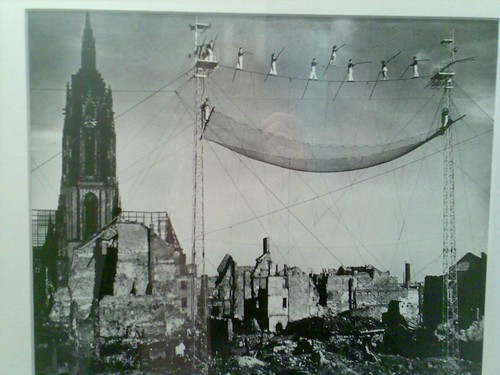 Photo of tightrope walkers above the ruins of post-war Frankfurt.