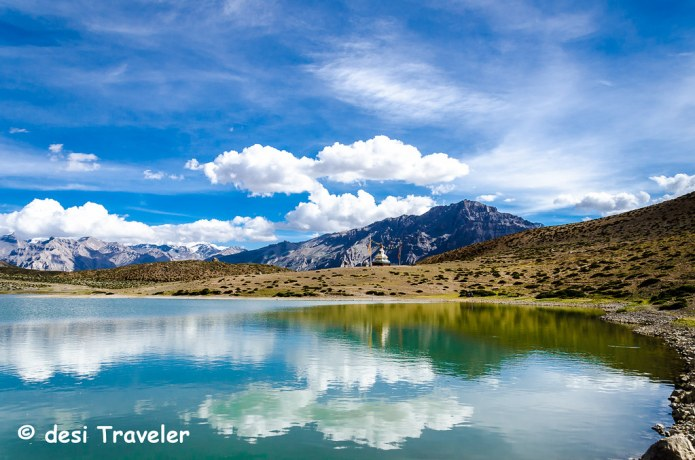 clouds reflecting in blue water of  Dhankar Lake Spiti