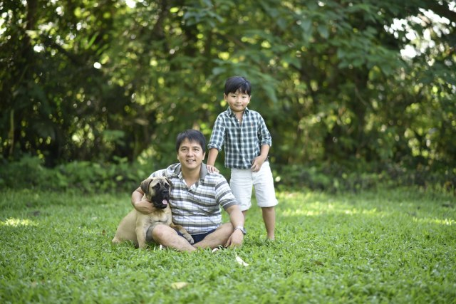 handsome father and son with bullmastiff puppy from Flat Rocks Bullmastiffs