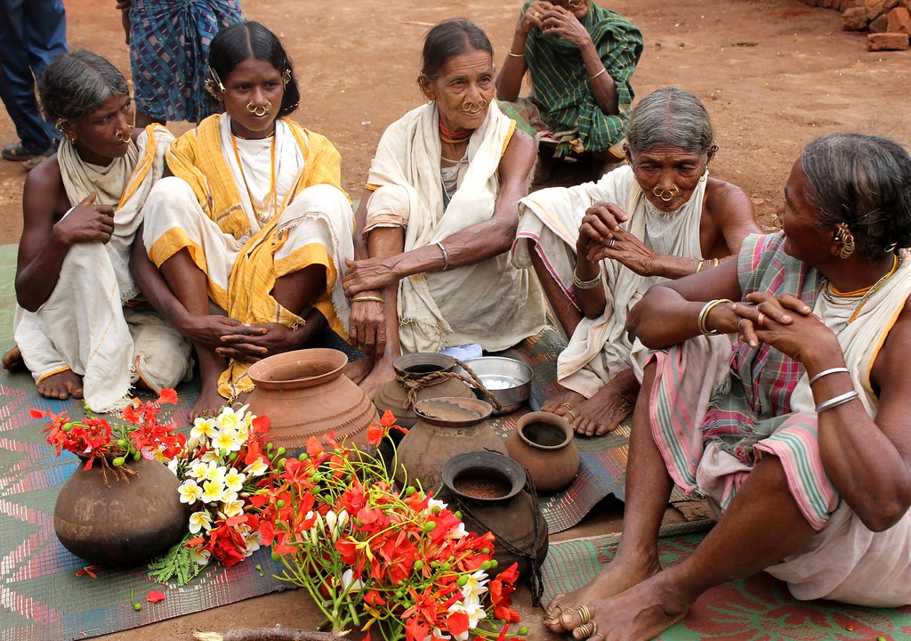 A group of priestesses discuss their plans before setting off in search of 'vanishing' millet varieties from a neighbouring village in eastern India. Credit: Manipadma Jena/IPS