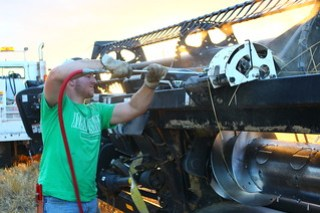 Cleaning off the header for the trip north.