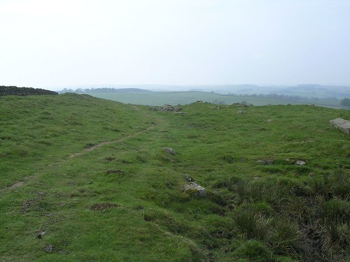 The shallow ditch to the left and the moundy wall to the right