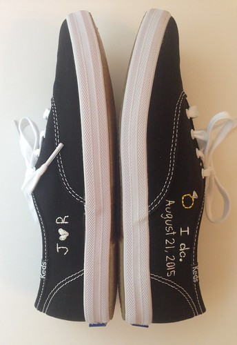 Black and white Keds with ring