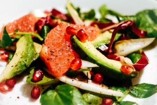Salad with pink grapefruit, avocado, pomegranate. And voatsiperifery pepper