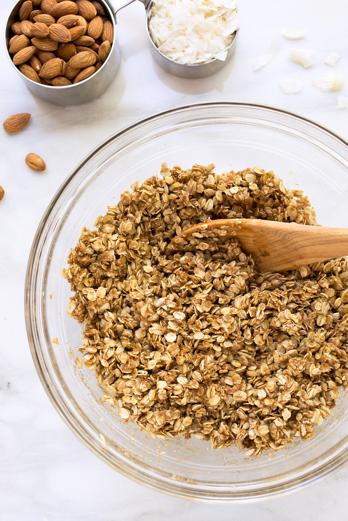 cherry almond granola ingredients in bowl