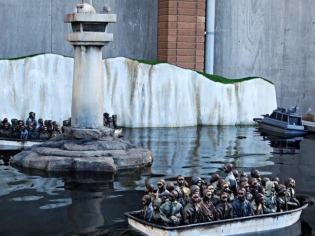 migrant crisis, dismaland, refugee boats, banksy