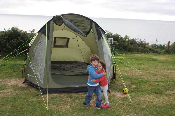 Silver strand camping in Wicklow, Ireland: Happy campers, the kids hugging each other to celebrate our tent, up for the night