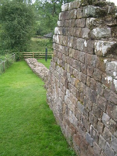 Curtain wall with restored facing stones at Hare Hill