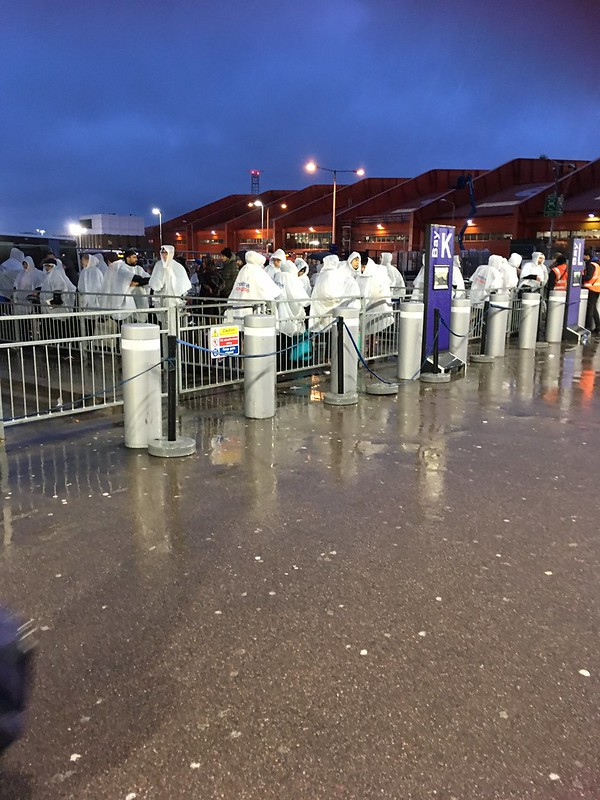 It looks as if we were dressed in decontamination suits, but these were ponchos we were given as we waited in the rain and cold for a coach from Luton Airport to Heathrow Airport that never turned up.
