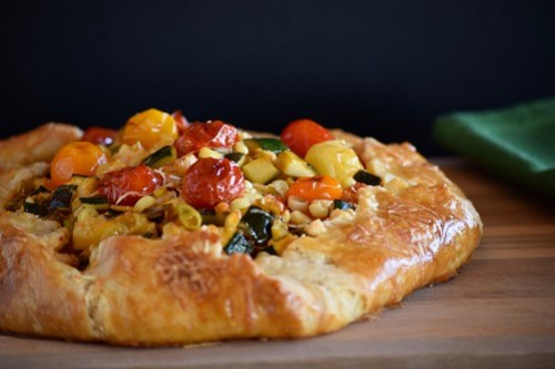burst tomato galette with corn and zucchini