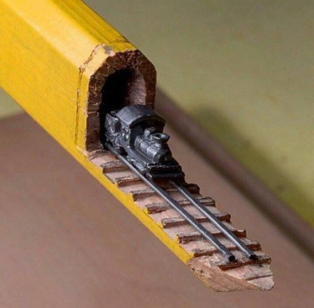 A train carved from a pencil by artist Cindy Chinn.
