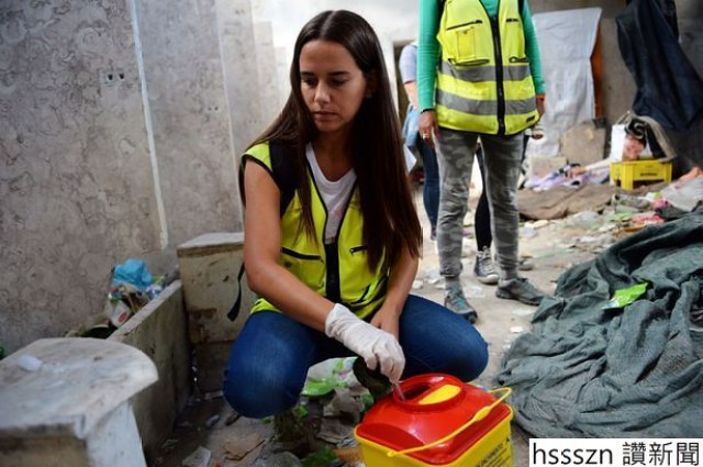 Maria-Carmona-heads-The-Lisbon-outreach-team-clearing-drug-paraphenalia-in-a-problematic-suberb_615_409