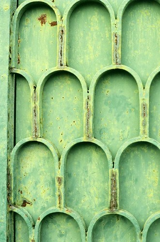 Green door with rust