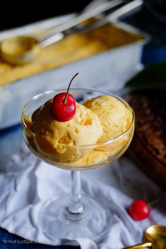 Dreamy Creamy Mango Ice Cream on notjustspice.com
