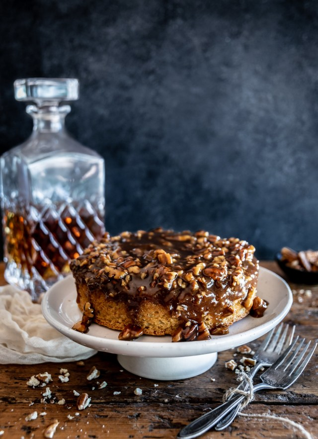 a browned butter cake draped with warm bourbon pecan caramel