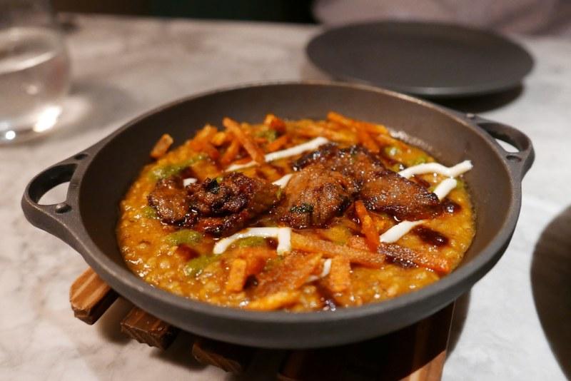 Millet Khichdi, beef laal maas, parmesan yogurt $12