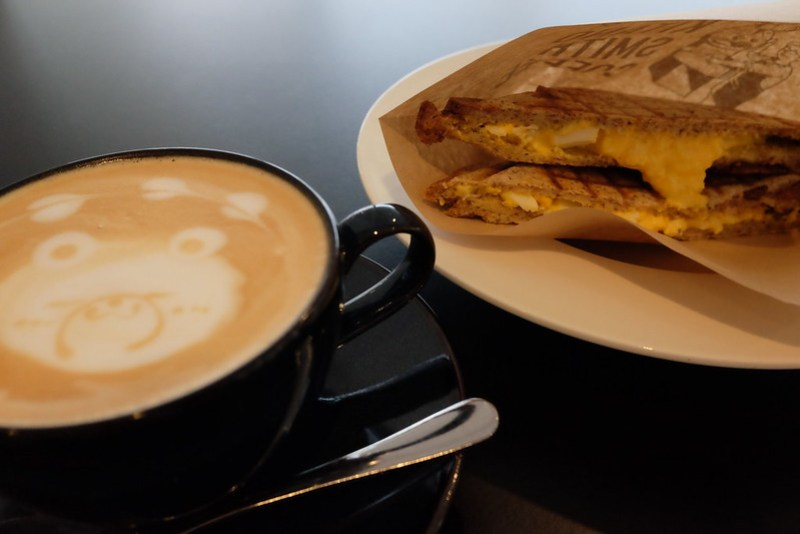 cafe latte with egg sandwich