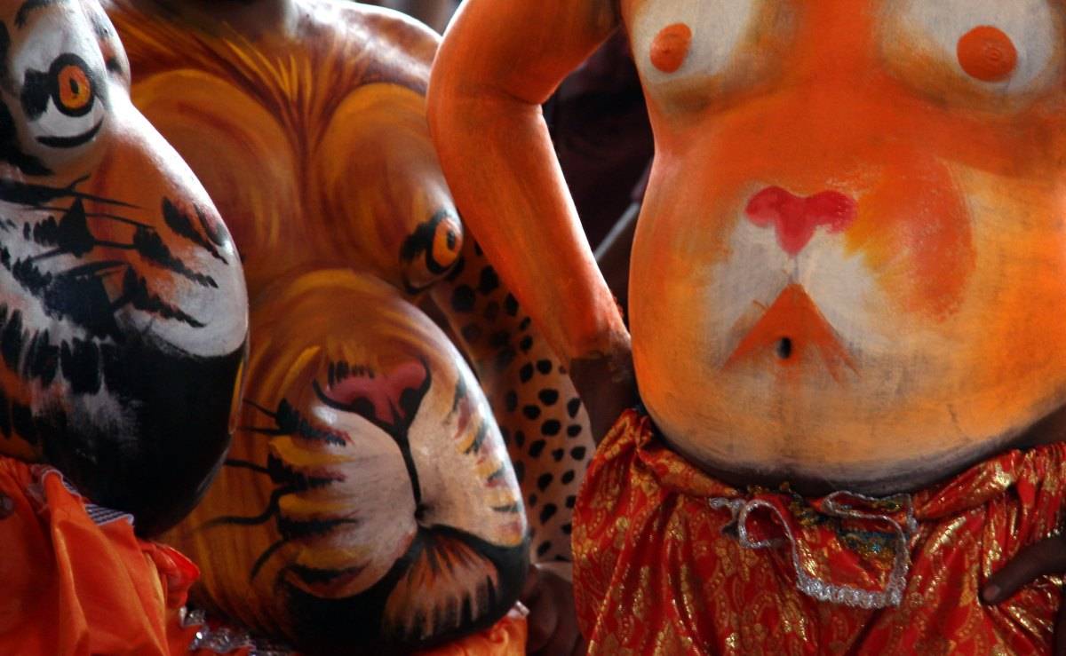 Pulikali tiger dance features beautiful body painting.