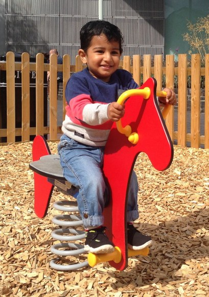 Adi riding wooden horse
