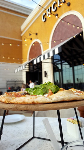 pizza al fresco. From Why You Need to Try Bravo Cucina Italiana's Spring Promotion